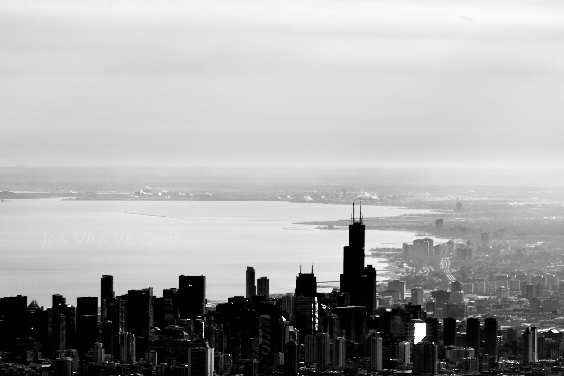 Black and white aerial photograph of the city of Chicago on Lake Michigan