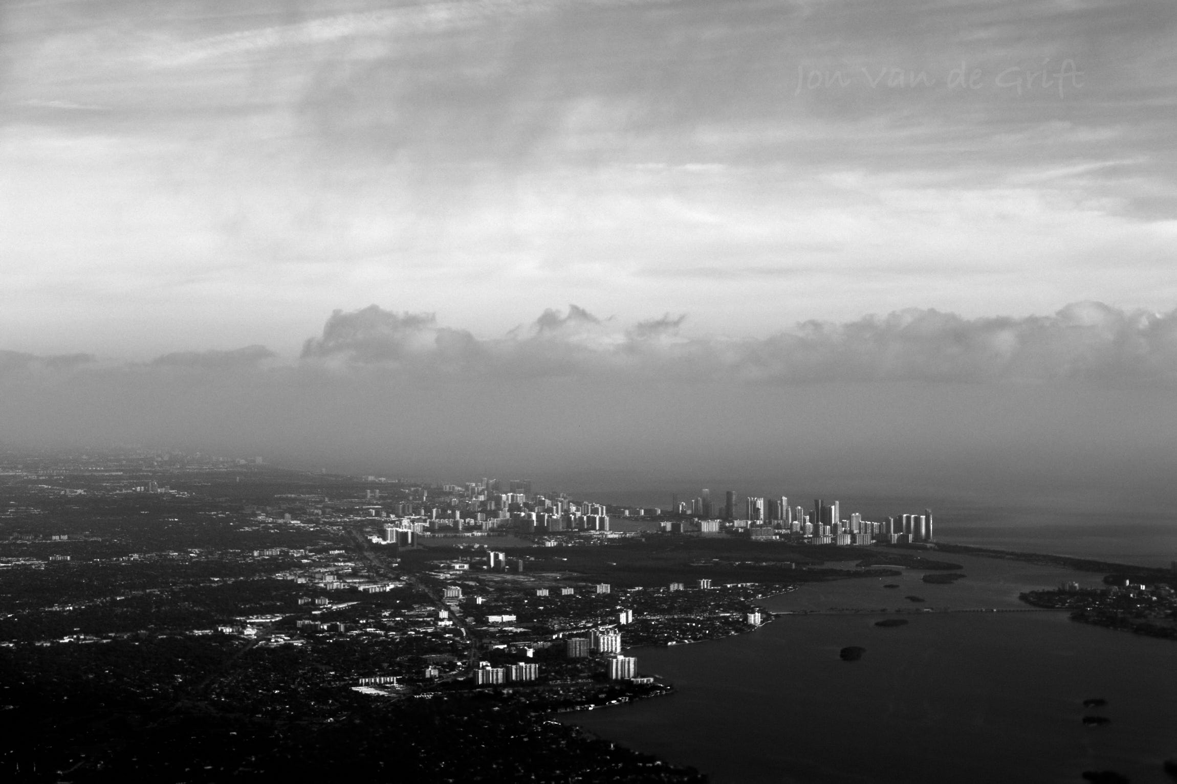 Black and white aerial photograph of buildings near the city of Miami.