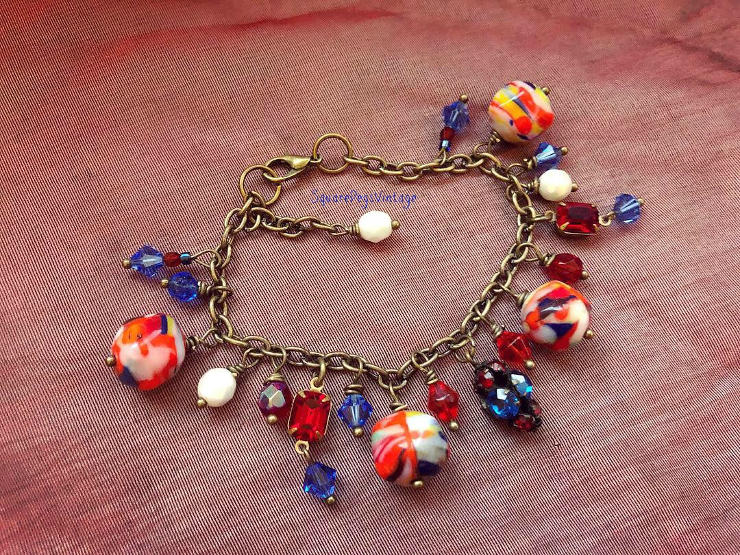 One of a kind design with colorful vintage glass, and it's adjustable.