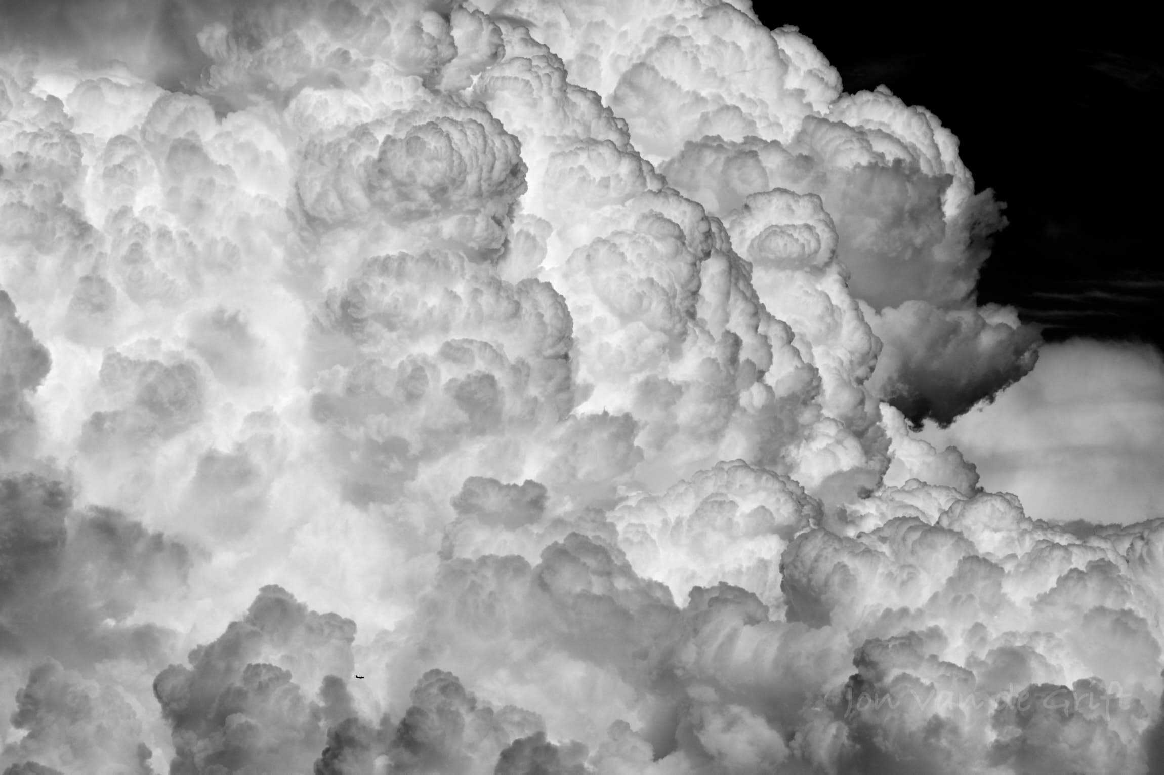 Black and white aerial photograph of a strong thunderstorm in the North American Monsoon