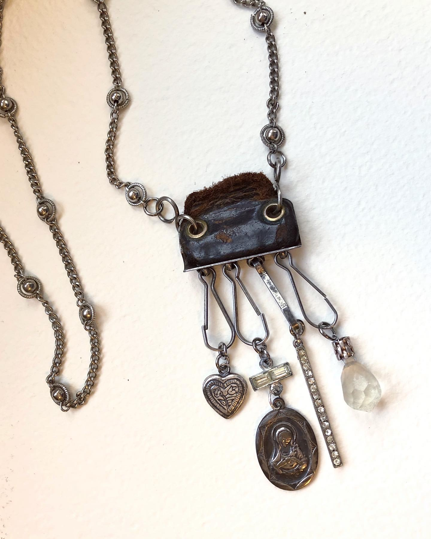 Nice assemblage of vintage items dangle in this one of a kind piece!
