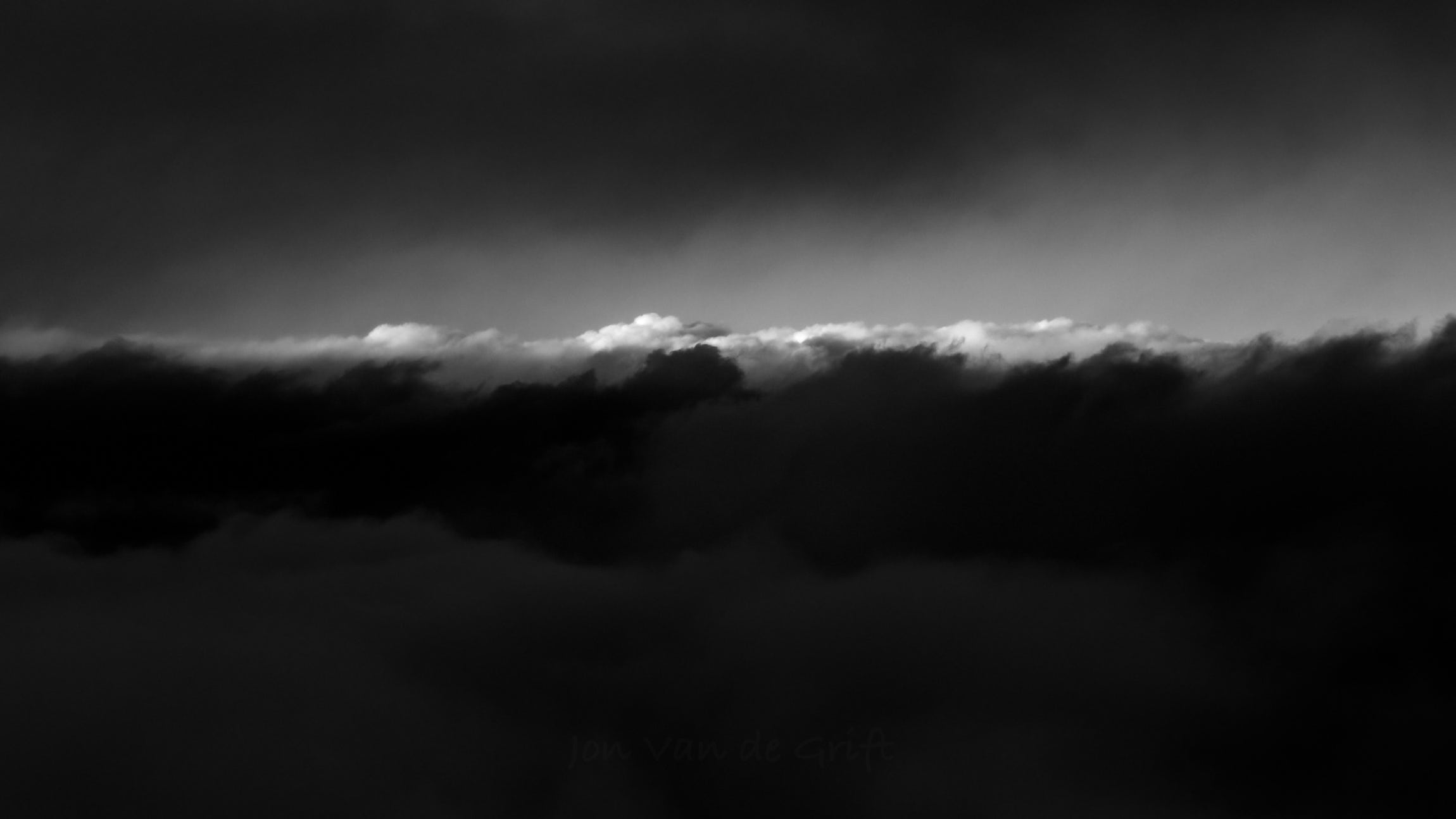Black and white aerial photograph taken at cloud level.