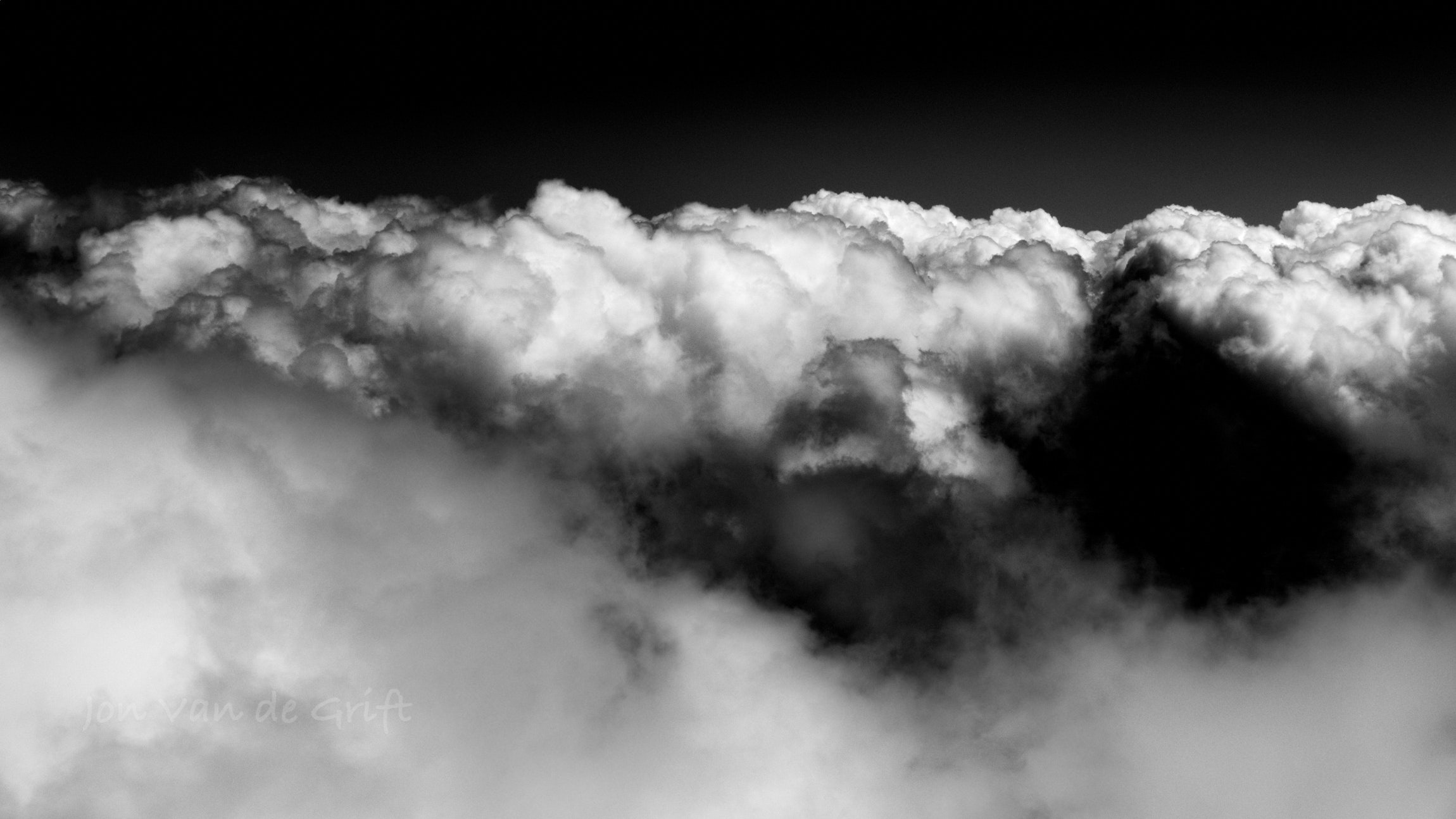 Black and white aerial photograph of a developing storm.