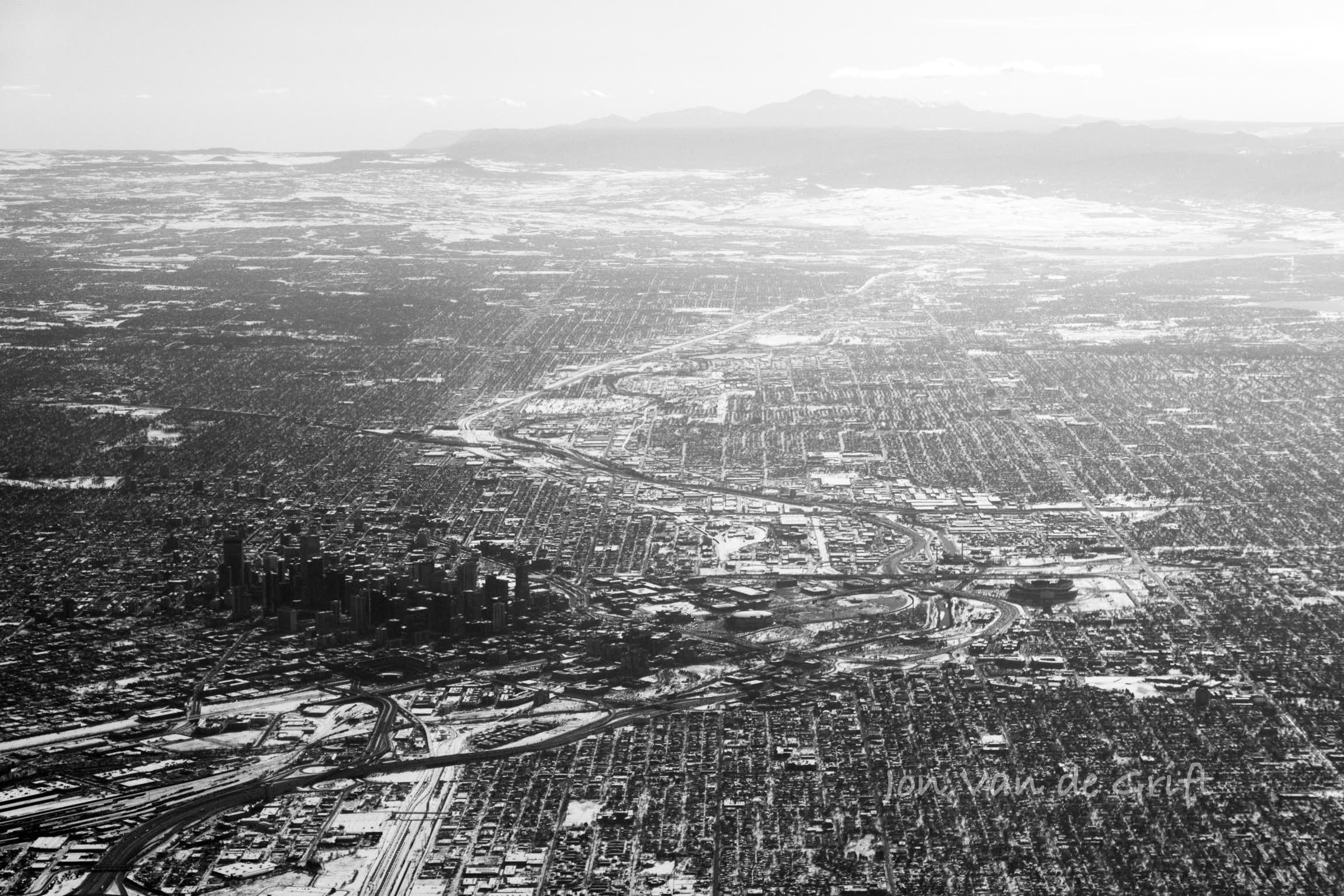 Black and white aerial photograph of the city of Denver near the Colorado Front Range.