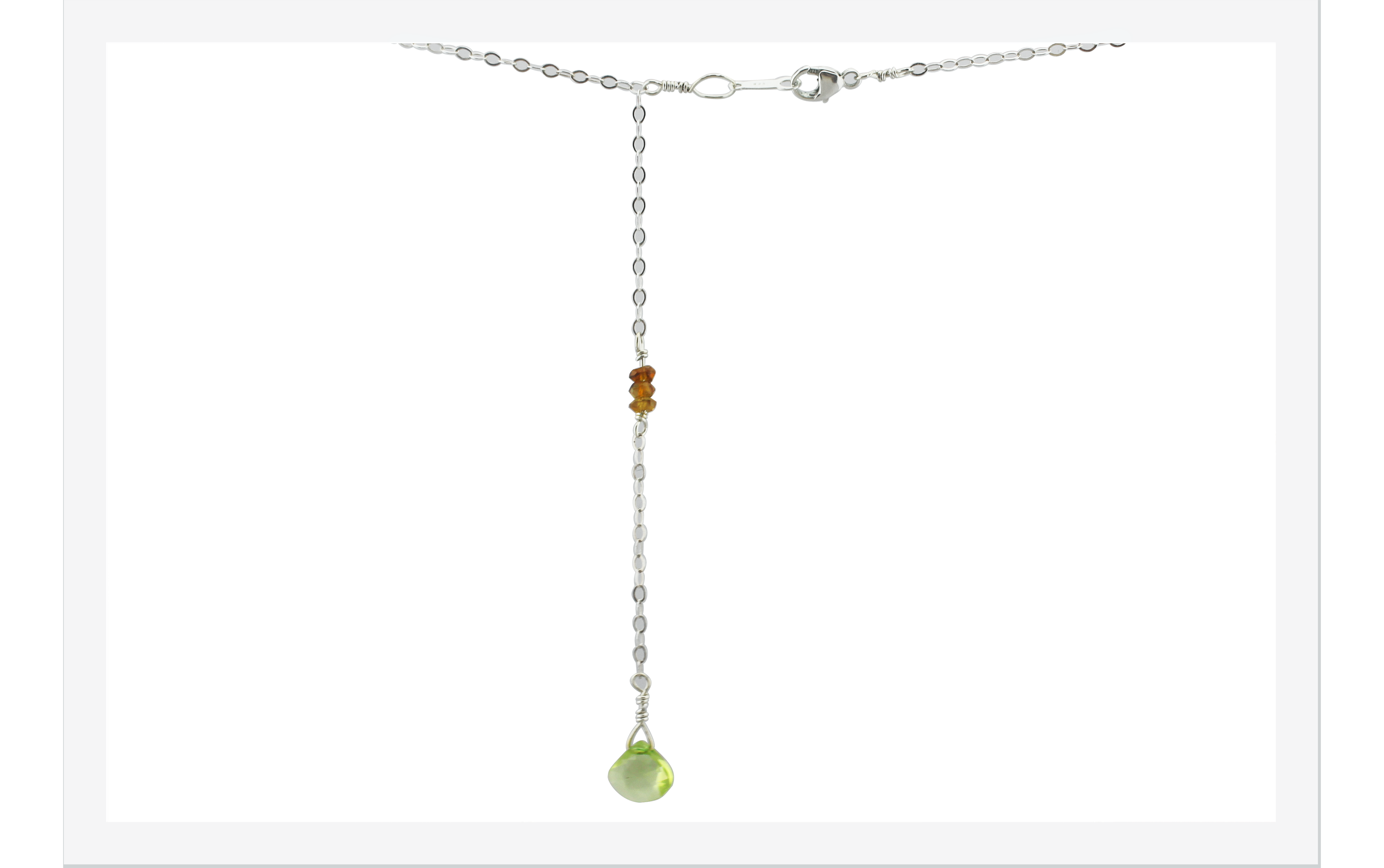 display of back drop necklace with peridot