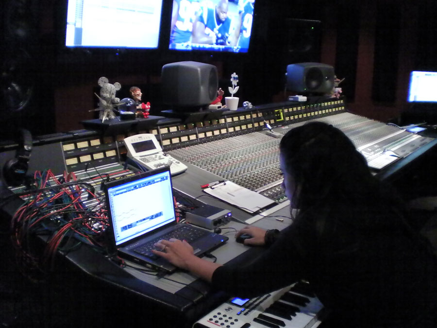 Christina laying synth tracks at Tommy Lee's Atrium Studios