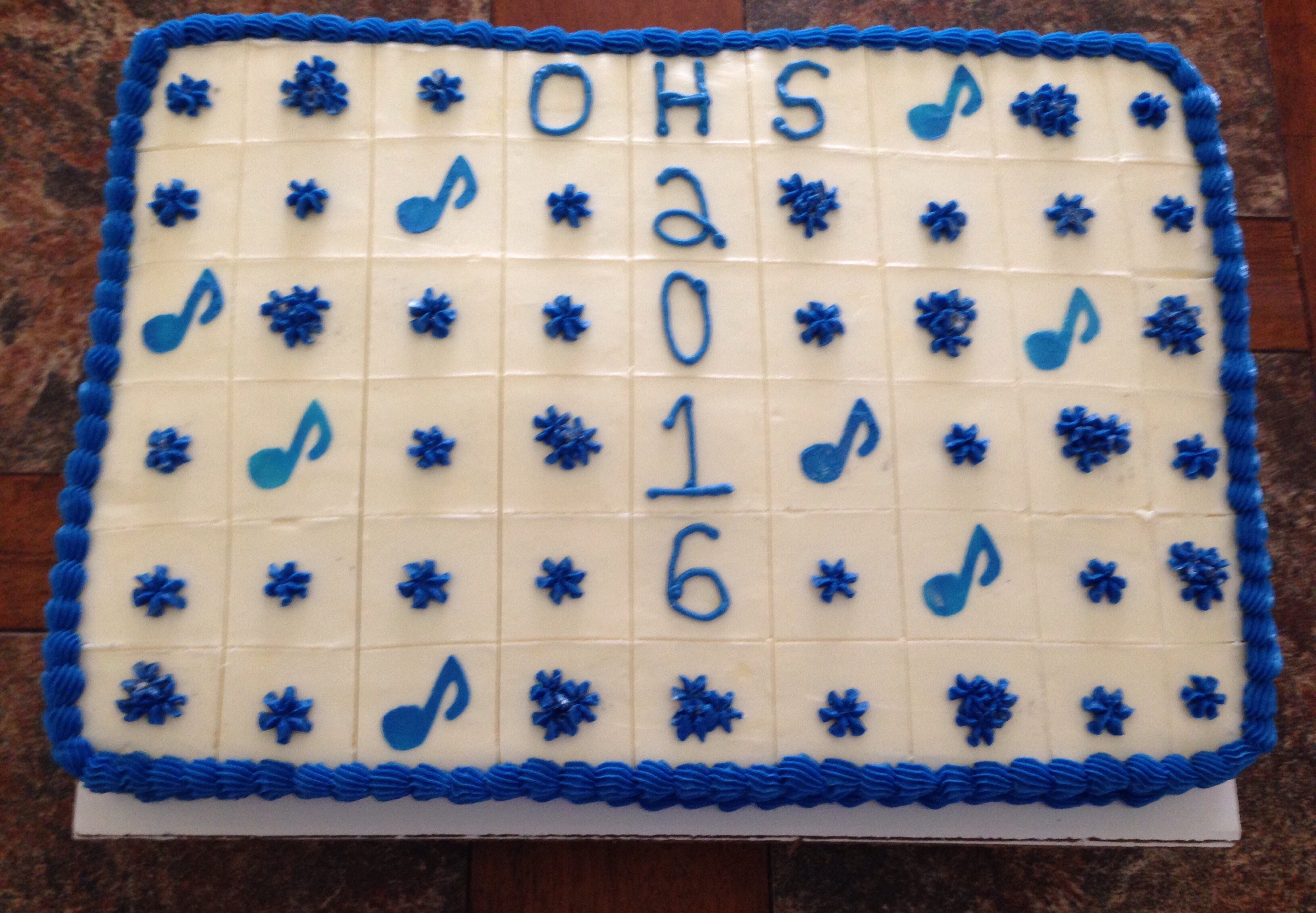 Owatonna H.S. Graduation Cake 2016. Marble Cake with Vanilla Buttercream. Music notes.