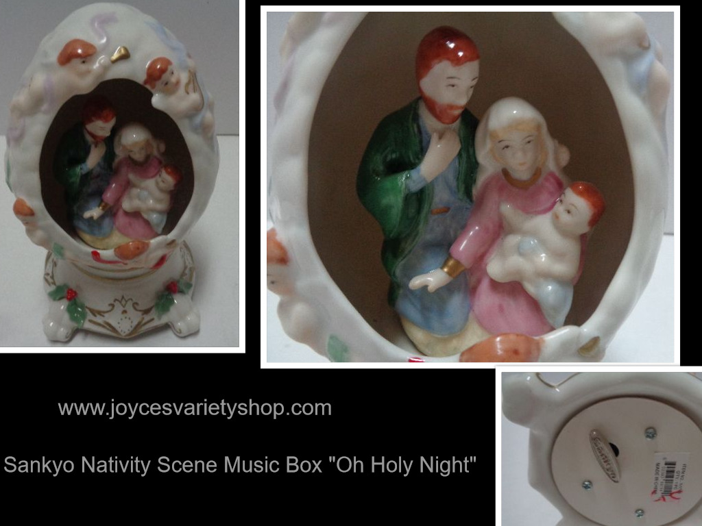 "Sankyo Porcelain Egg Shaped Nativity Scene Musical ""Oh Holy Night"""